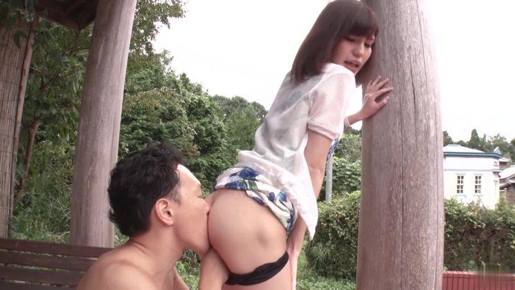 Gorgeous asian Yua Ariga giving feetjob in the open