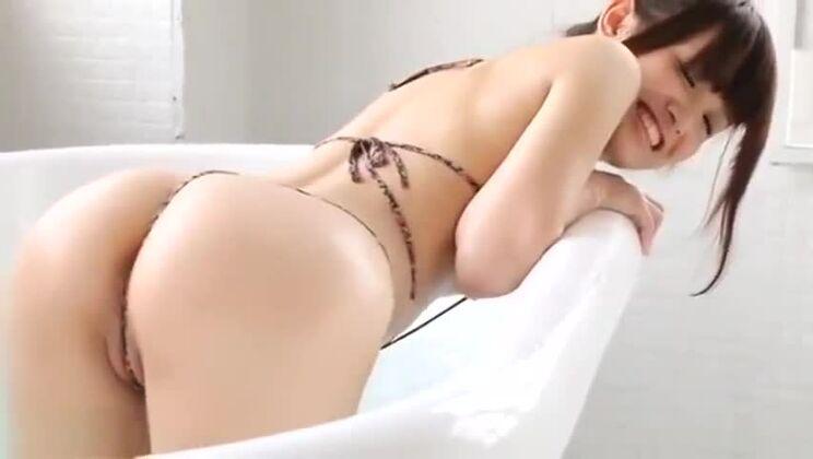Ayana Kobayashi soaping up in micro thong