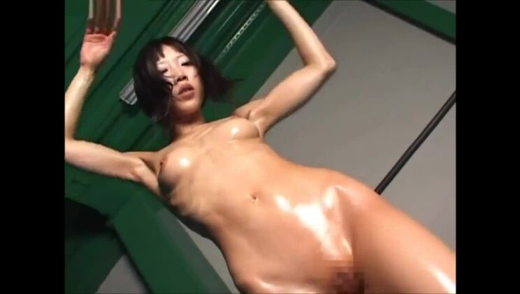 Oiled asian Gymnast Stretching